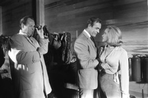 Hamilton on the set of Goldfinger with Connery and Honor Blackman