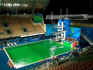 "Athletes are now reporting that the diving pool in this arena smells like ""a giant fart."""