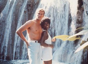 Gloria Hendry pictured with Roger Moore. Photo from indiewire.com